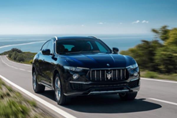 Black Maserati SUV on road